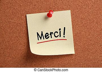 Merci Sticky Note - Merci sticky note pinned on corkboard