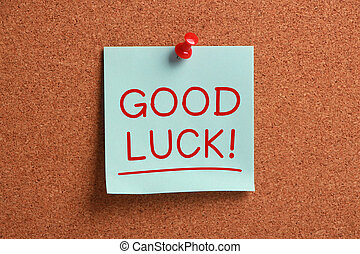 Good Luck ! - Good Luck sticky note pinned on cork.
