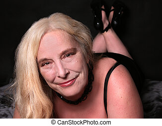 Sexy woman in her mid fifties - Blonde woman in her mid...