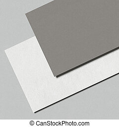 Closeup of two business cards isolated on a white background...