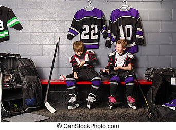 Hockey Arena Boys in Rink Dressing Room - Two Boys Get...