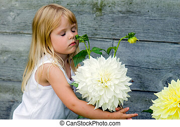 Dahlia Hug - Little girl hugging a dahlia.