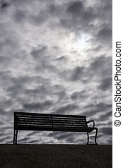 Bench With Dark, Moody Clouds - A solitary, lonely park...