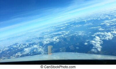 View of the Alps from cockpit - Aerial view of the Alps from...