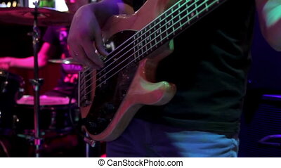 Bass-guitarist perform at a concert - Bass-guitarist play in...