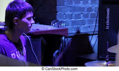 Drummer perform at a concert - Drummer play in a nightclub