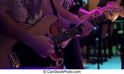 A few guitarists - Guitarists play in a nightclub