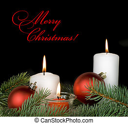 Christmas composition with a burning candles on a black...