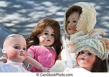 Antique dolls at a outdoor Paris flea market