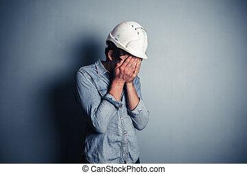 Upset blue collar worker - An upset blue collar worker is...