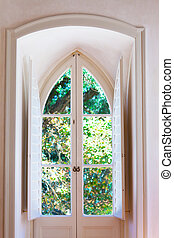 View in a garden through a decorative window