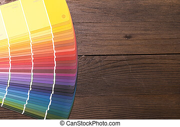 Color Catalogue on wooden desk - Colorful color paint...