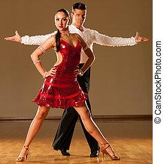 latino dance couple in action - dancing wild samba - latino...