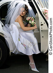 Smiling bride in wedding car limo