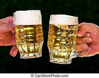 Two mugs of beer with us beer foam - Two mugs of beer with...