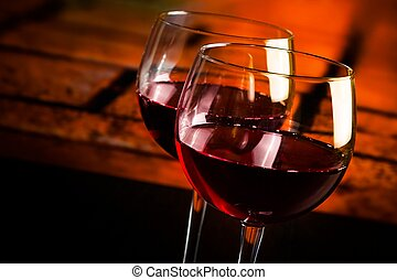 two red wine glasses on wood table with warm atmosphere background