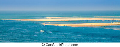 Seascape in Gironde - Sandy islands with two boats cruising...