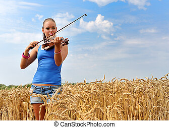 young attractive woman playing the violin