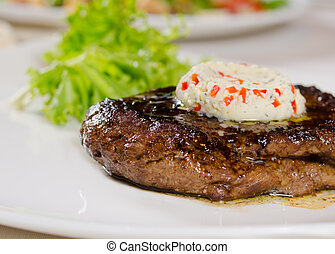 Close Up of Steak Topped with Herbed Butter