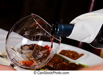 Pouring Red Wine into Glass - Close Up of Pouring Red Wine...