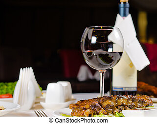 Glass of Wine Served with Ribs in Restaurant - Glass of Wine...