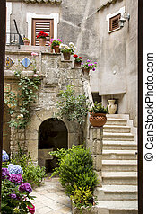 Patio in Italy - Little Italian courtyard with flowers and...
