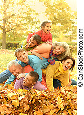 family in autumn park - fun walk a large family in the...