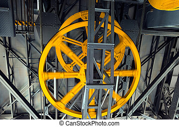 Yellow Wheels of Cableway - Mechanism of a funicular with...
