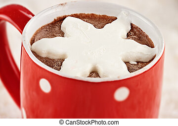 Hot Cocoa with Whip Cream - Vibrant red cup of hot chocolate...