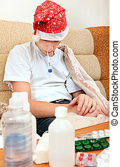 Sick Teenager with Thermometer - Sick Teenager in Santa Hat...