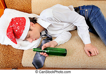 Drunken Teenager sleeping in Santa Hat and Bottle of the...