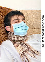 Sick Teenager in Flu Mask on the Sofa at the Home