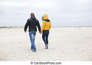 couple at the beach in winter