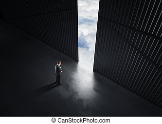 man thinking - businessman thinking and open doors to sky