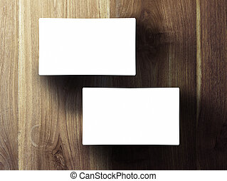 two business cards stack up on wooden table