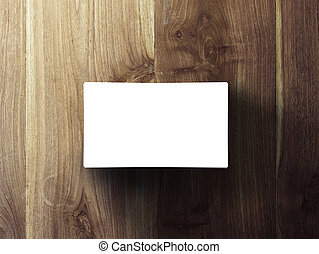 blank business cards stack up on wooden table