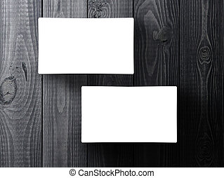 business cards - two business cards stack up on gray table