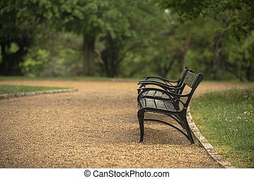 Stylish bench in autumn park closeup photo
