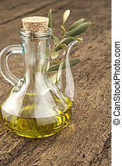 A glass jar with olive oil