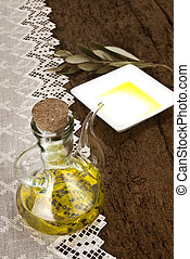 Glass jar with olive oil rustic background