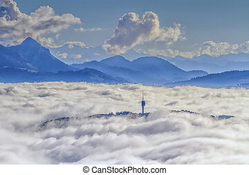 Mont-Gibloux and Alps mountains upon clouds, Fribourg,...