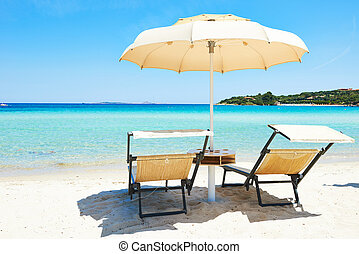 Beach chair with umbrella for rest and relaxation on resort...