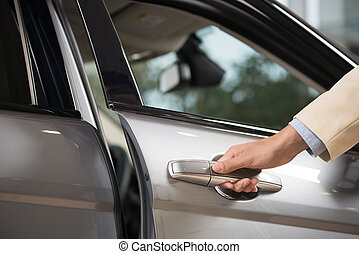 Car door handle - Close up of human male hand opening car...