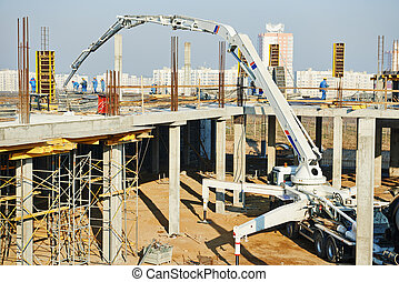 building works with concrete pump - construction building...