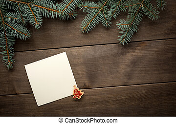 Christmas decoration. Blank scroll for text between fir...