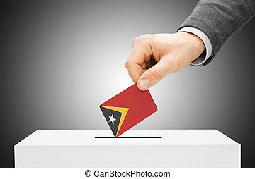 Voting concept - Male inserting flag into ballot box - East...