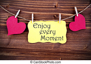 Yellow Lable Saying Enjoy Every Moment On Wooden Background...