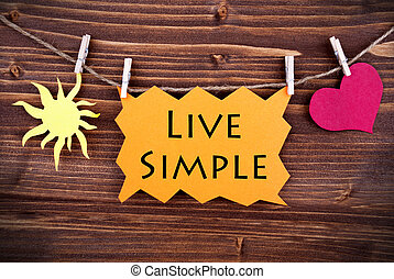 Orange Lable Saying Live Simple On Wooden Background Hanging...