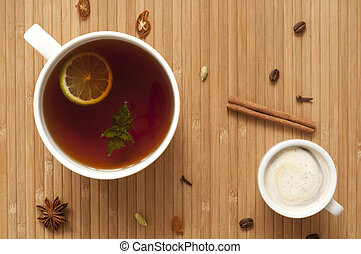 Spiced tea and coffee - Cup of tea with lime, mint and cup...