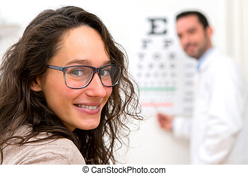 Young attractive woman doing optician test - View of a Young...